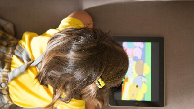 Little girl with ipad