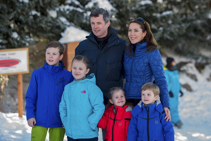 The family pose for photographers on their holiday in Verbier, Switzerland.