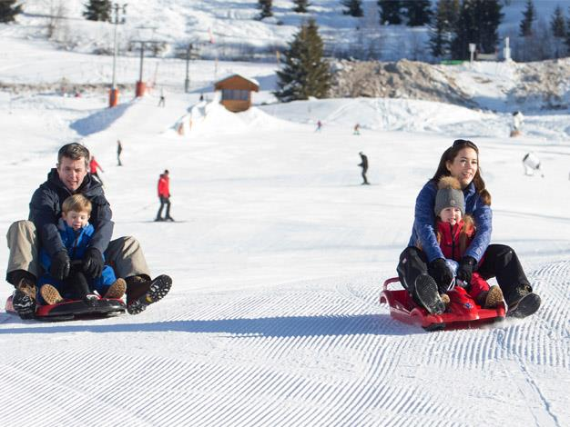 Prince Frederick and Princess Mary show off their tobogganing prowess.