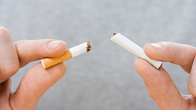 Breaking a cigarette in half