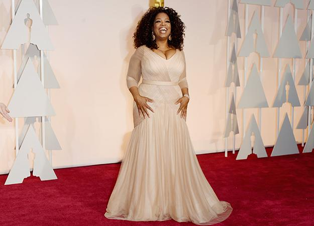 Oprah Winfrey looked stunning on the red carpet in this blush number.