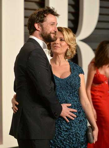Noah Wyle and his pregnant wife Sarah Wells.