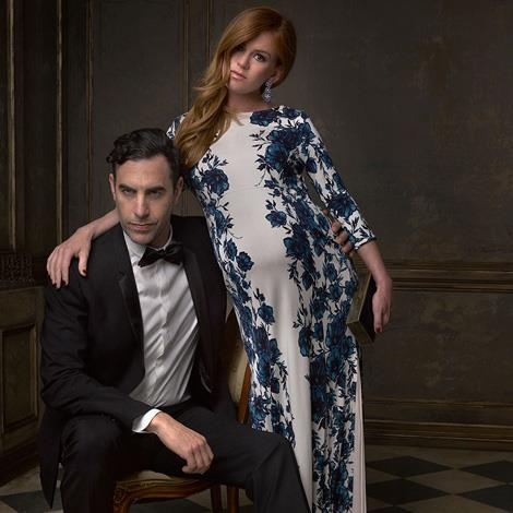 A heavily pregnant Isla Fisher was blooming lovely in her portrait with funny man husband Sacha Baron Cohen.