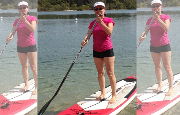 Somthing she was never supposed to do: Gai enjoying the sun on her paddle board on the Gold Coast.