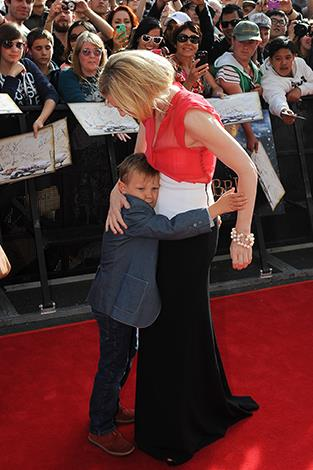 Cate gets a cuddle from her son at the premier of 'The Hobbit' in New Zealand.