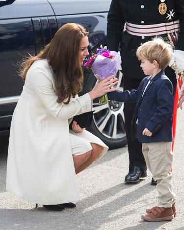 Downton Abbey actor Zack Barker greeted the Duchess of Cambridge with a bright bunch of flowers as she walked onto the set of the popular television show.