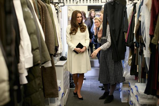 Kate looked at home in the costume room, admiring the costumes worn by cast on the show.