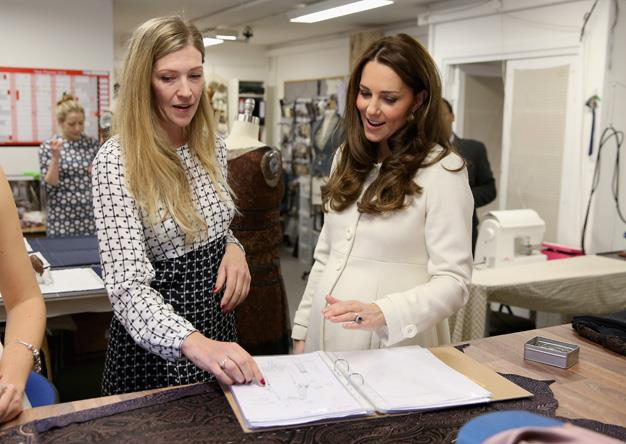 The Duchess was shown the costume designs by crew on set, looking at the design pages before they come come to life.