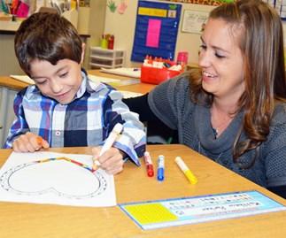 Teacher Lindsay Painter with student Matthew Parker.