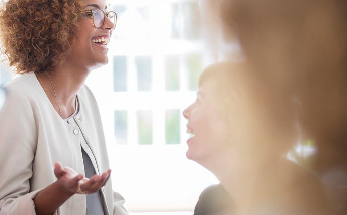 Business woman laughing in meeting
