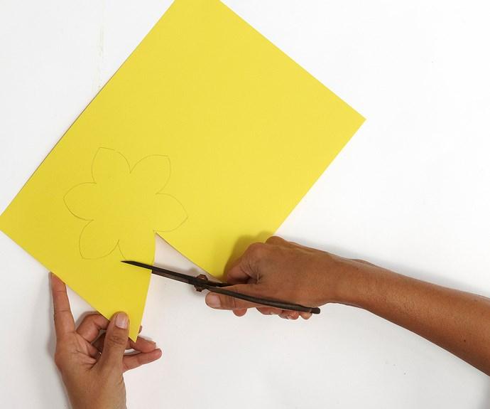 hands cutting craft paper