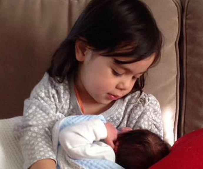 Penny Wong's daughter, Alexandra, holds baby Hannah