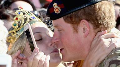 In for the kiss! Excited fans flock for Prince Harry