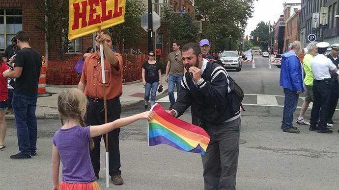 WATCH: The amazing moment this little girl stands up to an anti-gay preacher