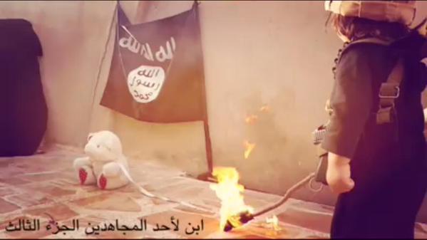 Jihadi infant burning teddy bear