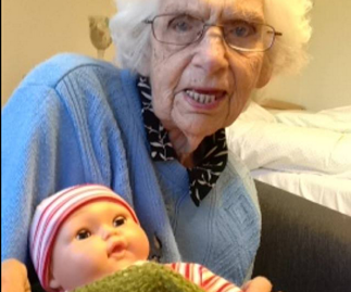Amazing pictures of grandmother caring for baby doll go viral