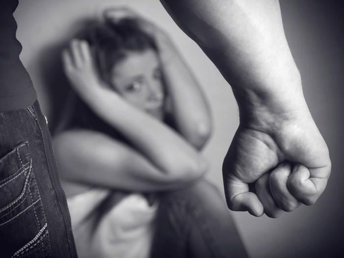 man threatening woman - domestic violence