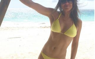 Liz Hurley in yellow bikini