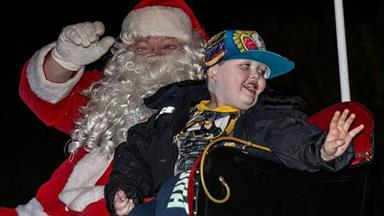 Town celebrates Christmas early for terminally ill boy