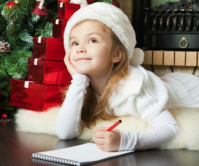 Little girl writing to Santa