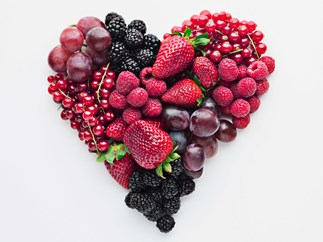Fruit and berries arranged in a love heart