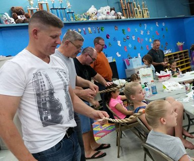 Dads attend 'doing your daughter's hair' class
