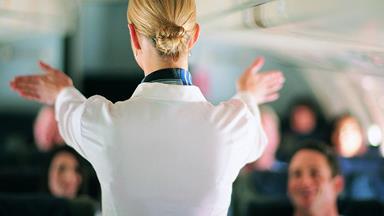 Air hostesses in mid-flight fist fight