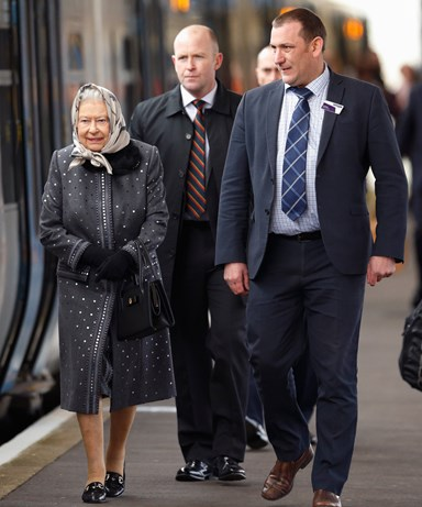 Queen joins commuters on train back to London