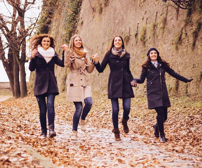 Happy women walking together