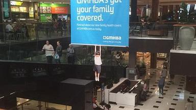 Hanging child in Melbourne shopping centre angers shoppers