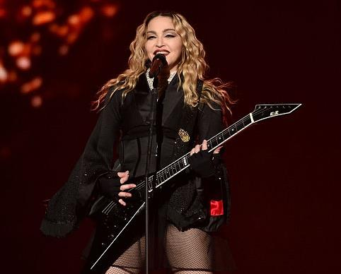 Madonna exposes fan's breast on stage