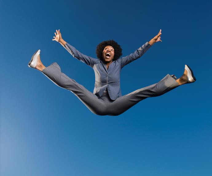 happy woman jumping in air