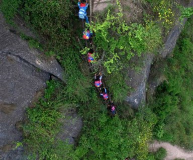 Children climb 800m cliff to get to and from school