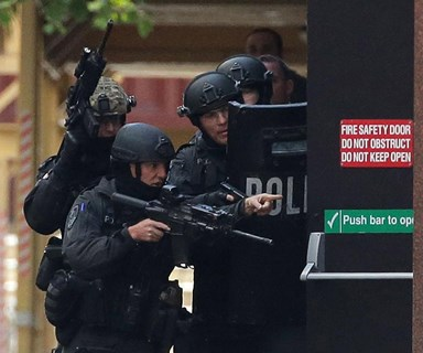 Police chief left before Sydney siege ended