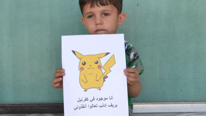 Syrian children hold Pokémon pictures in hope of being saved