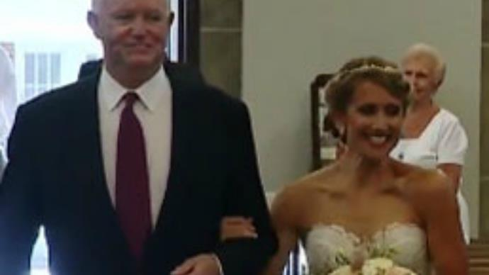 Bride gets walked down the aisle by man who received her dad's heart