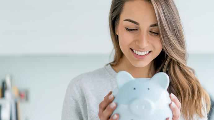 Woman saving money piggybank