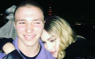 Madonna stands by 16-year-old son Rocco following his arrest