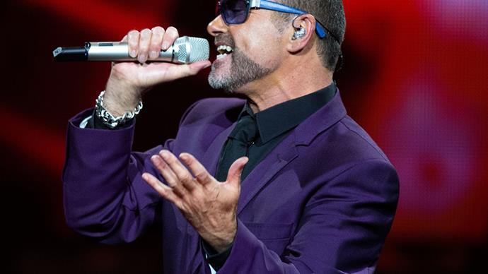 George Michael performing on stage.