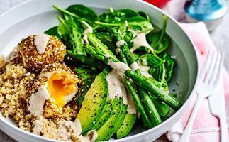 Breakfast bowl with asparagus, spinach, quinoa, and dukkah eggs.