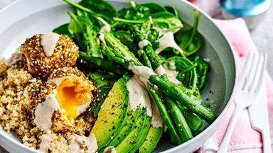Healthy breakfast bowl with dukkah eggs and quinoa