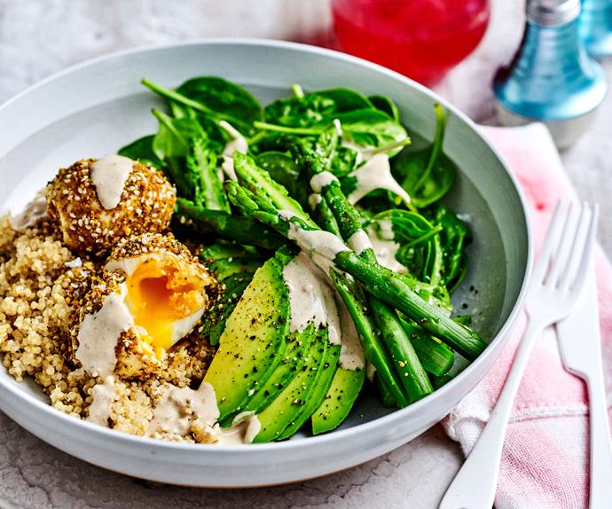 Breakfast bowl with asparagus, spinach, quinoa, and dukkah eggs.