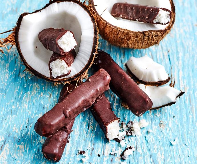 Dark chocolate bars with coconut on display with coconut shells.