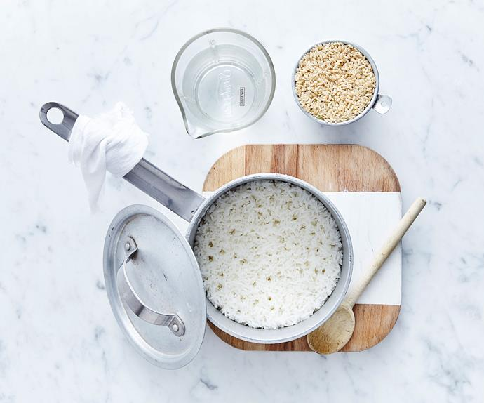 white rice being cooking in a pan