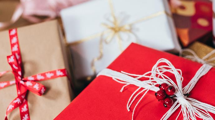 three christmas gift boxes wrapper with red paper