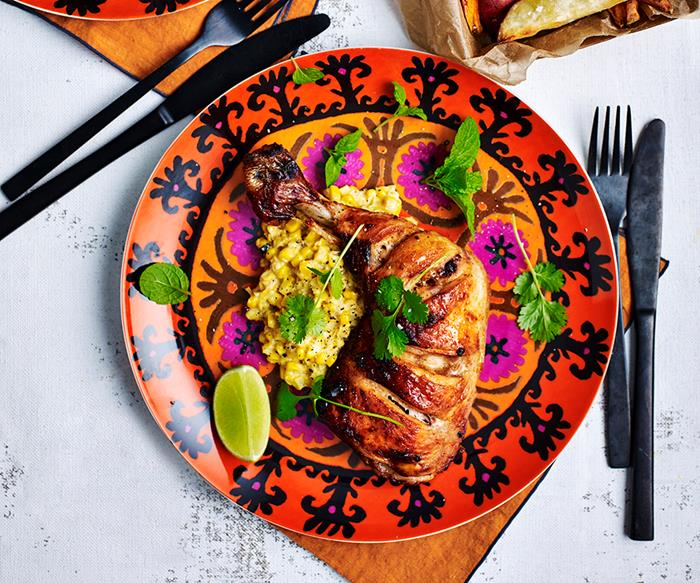 Chipotle spiced chicken pieces with creamed corn and sweet potato wedges
