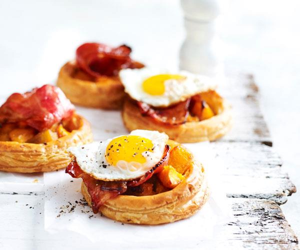 """These easy tarts with [pumpkin, maple-bacon and fried egg](https://www.womensweeklyfood.com.au/recipes/pumpkin-and-maple-bacon-tarts-with-fried-eggs-31312
