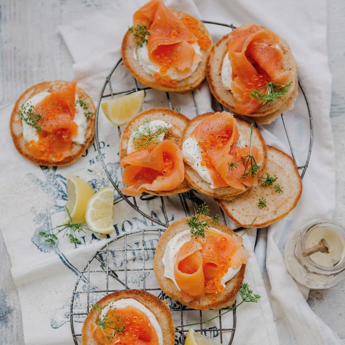 "**[Blinis with smoked salmon](https://www.womensweeklyfood.com.au/recipes/blinis-with-smoked-salmon-11502|target=""_blank"")**  These light and fluffy mini savoury pancakes make the ultimate dinner party starter or appetiser, and are divine served with a dollop of fresh cream, and tender smoked salmon."