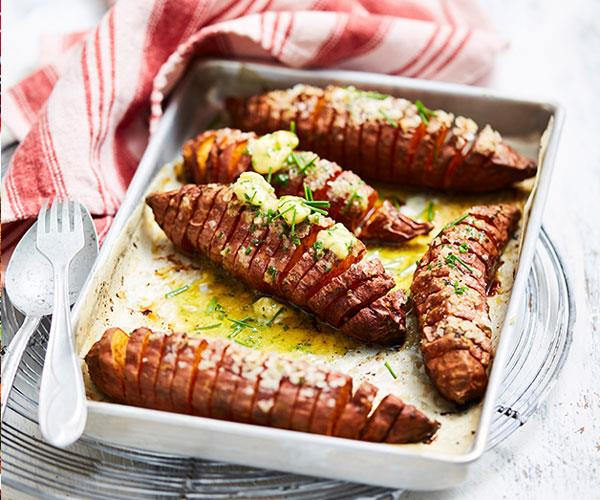 "**[Spiced sweet potatoes with whipped chive butter](https://www.womensweeklyfood.com.au/recipes/spiced-sweet-potatoes-with-whipped-chive-butter-31428|target=""_blank"")**  A fancy side dish of baked sweet potato flavoured with garlic, cinnamon and chive butter."