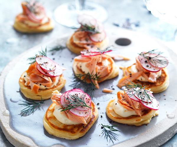 "**[Spelt blini with hot smoked salmon and crème fraîche](https://www.womensweeklyfood.com.au/recipes/spelt-blini-with-hot-smoked-salmon-and-creme-fraiche-31472|target=""_blank"")**  Entertaining is simple with these quick spelt blini topped with hot-smoked salmon and crème fraîche"